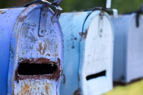 Line of Classic Rusty Blue Rural US Mailboxes