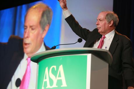 Bob Blancato waving from behind a podium at ASA Conference