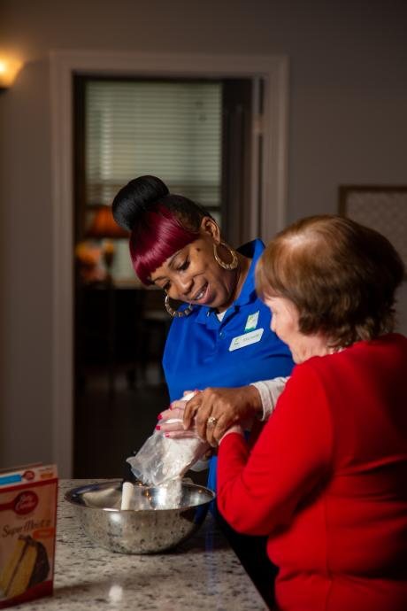 ursing assistant Michelle Godwin cares for a woman in a Florida memory care facility. Photo by Kristen Blush