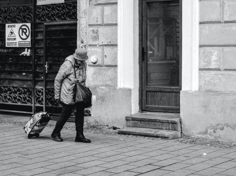Older woman walking alone in city